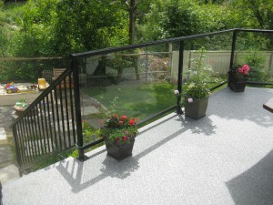 Railing. Glass Panels.  Stairs. Vinyl Decking.